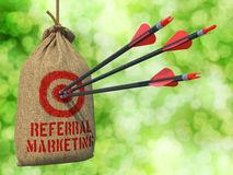 referral-marketing-arrows-hit-target-three-red-hanging-sack-green-bokeh-44407985